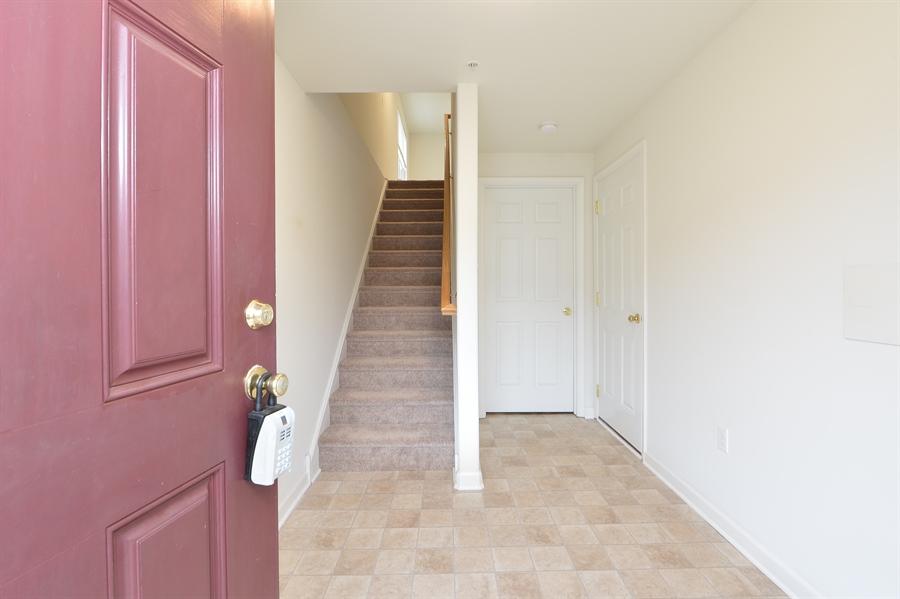 Real Estate Photography - 125 Ben Boulevard, Elkton, DE, 21921 - Foyer, access to garage with new door opener