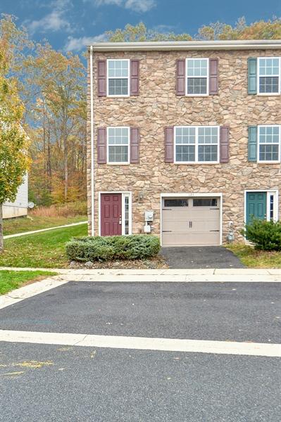 Real Estate Photography - 125 Ben Boulevard, Elkton, DE, 21921 - Stone front, end unit, garage with new door opener
