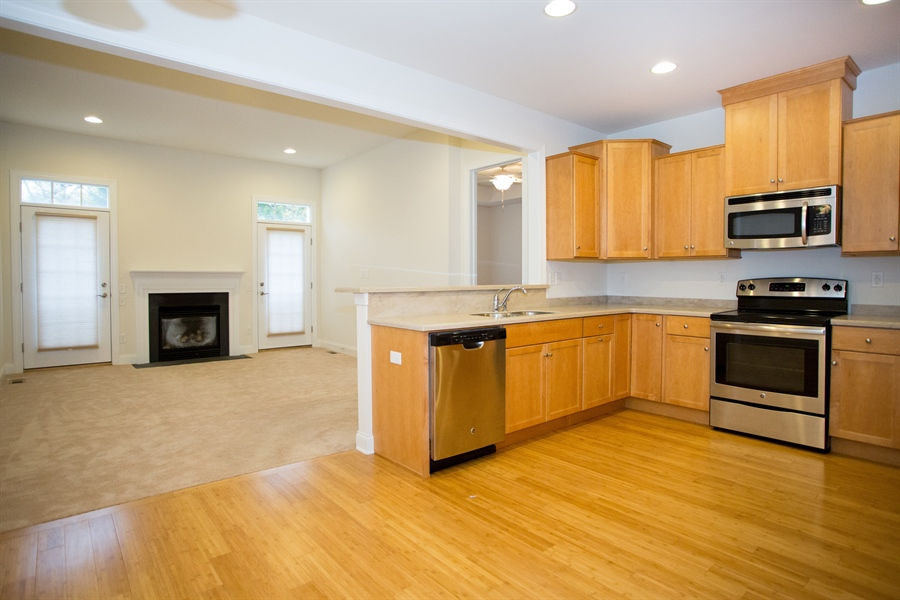 Real Estate Photography - 148 Landis Way N, Wilmington, DE, 19803 - Kitchen opens to dining area and family room!