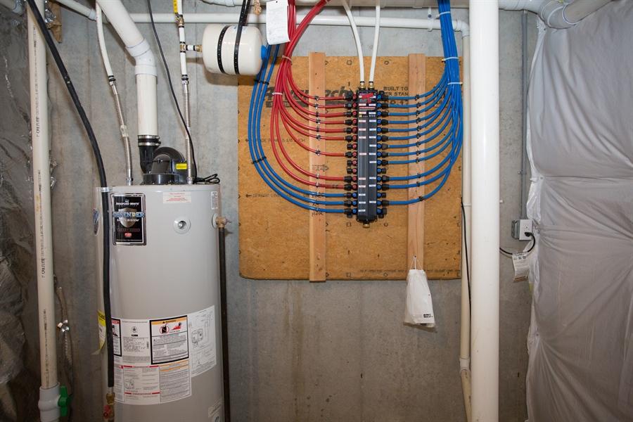 Real Estate Photography - 148 Landis Way N, Wilmington, DE, 19803 - Plumbing manifold in bsmnt for individual shutoffs