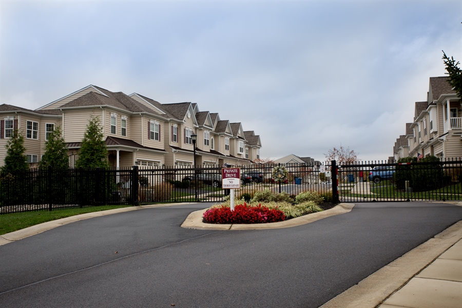 Real Estate Photography - 148 Landis Way N, Wilmington, DE, 19803 - Gated entry to Brandywine Town Center at rear!