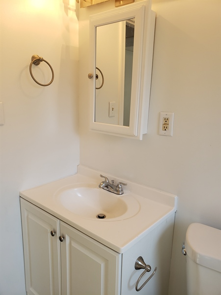 Real Estate Photography - 56 Evergreen Dr, Dover, DE, 19901 - Bathroom vanity