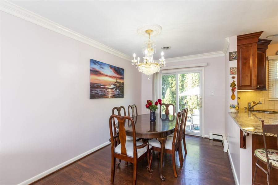Real Estate Photography - 2100 Elder Dr, Wilmington, DE, 19808 - Dining area with sliders to patio