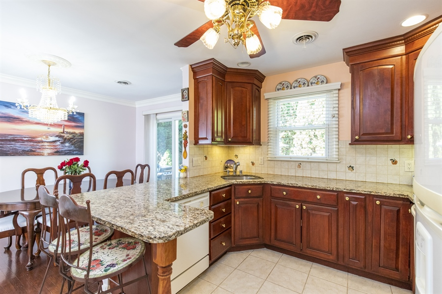Real Estate Photography - 2100 Elder Dr, Wilmington, DE, 19808 - Gorgeous cherry cabinetry & granite