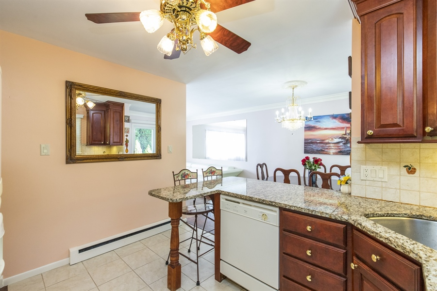 Real Estate Photography - 2100 Elder Dr, Wilmington, DE, 19808 - Kitchen is already open to dining room!