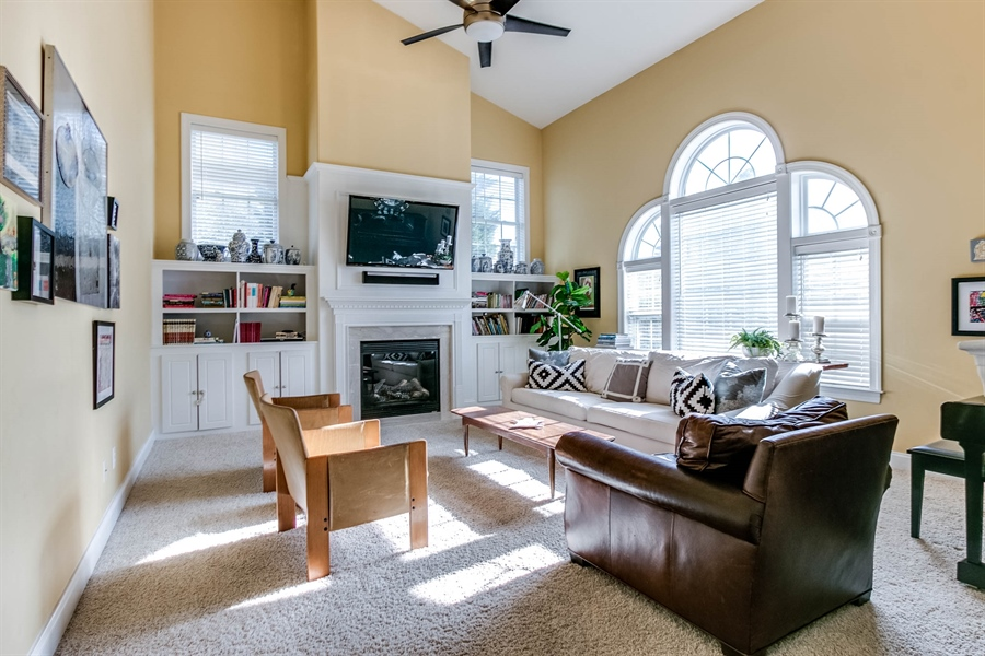 Real Estate Photography - 104 Cezanne Ct, Landenberg, PA, 19350 - Family Room - Built-In Cabinetry & Gas Fireplace