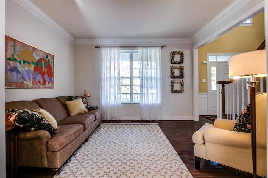 Real Estate Photography - 104 Cezanne Ct, Landenberg, PA, 19350 - Living Room - Hardwood Flooring & Crown Molding