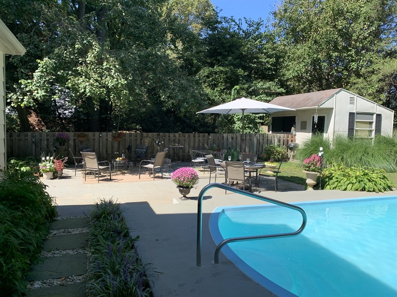 Real Estate Photography - 2 Jacqueline Dr, Hockessin, DE, 19707 - Backyard oasis with patio and in-ground pool