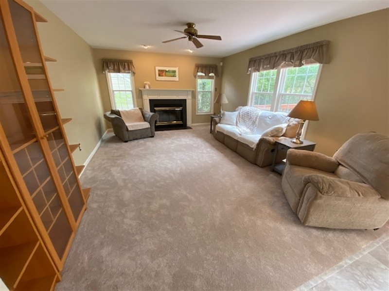Real Estate Photography - 17 Westwoods Blvd, Hockessin, DE, 19707 - Family Room Hosts Wood-Burning Fireplace