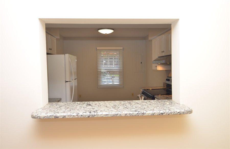 Real Estate Photography - 1508 N Lincoln St, Wilmington, DE, 19806 - Kitchen Pass Through to Dining Room