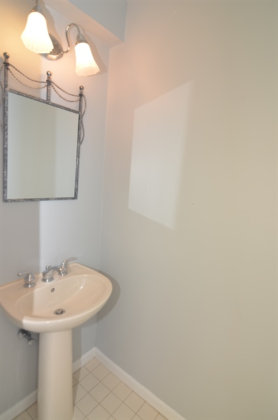 Real Estate Photography - 1508 N Lincoln St, Wilmington, DE, 19806 - Pedestal Sink in First Floor Powder Room