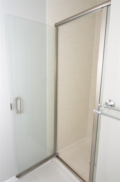 Real Estate Photography - 1508 N Lincoln St, Wilmington, DE, 19806 - In-Suite Master Bath With Glass Shower Door