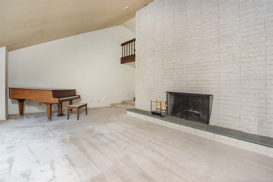 Real Estate Photography - 623 Shipley Rd, Wilmington, DE, 19809 - Wood Buring Fireplace in Family Room
