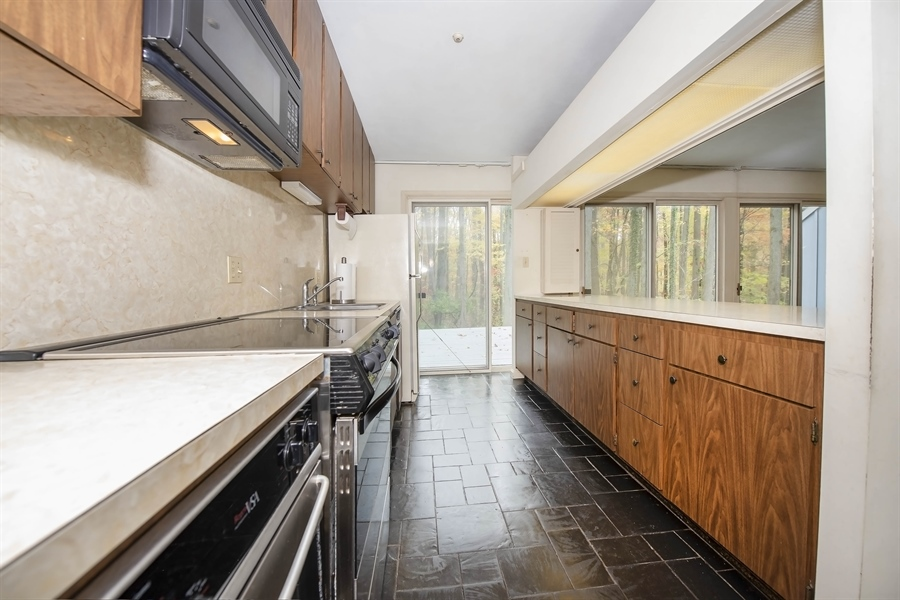 Real Estate Photography - 623 Shipley Rd, Wilmington, DE, 19809 - Rear Deck Accessible From All Areas of Kitchen