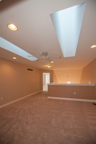 Real Estate Photography - 230 Niagara Falls Dr, Wilmington, DE, 19808 - A long view of the loft showing skylights and door