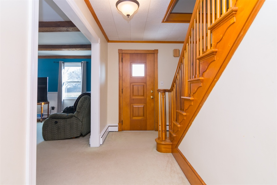 Real Estate Photography - 4535 Brenford Rd, Smyrna, DE, 19977 - Gorgeous solid wood stairs leading to 2nd story