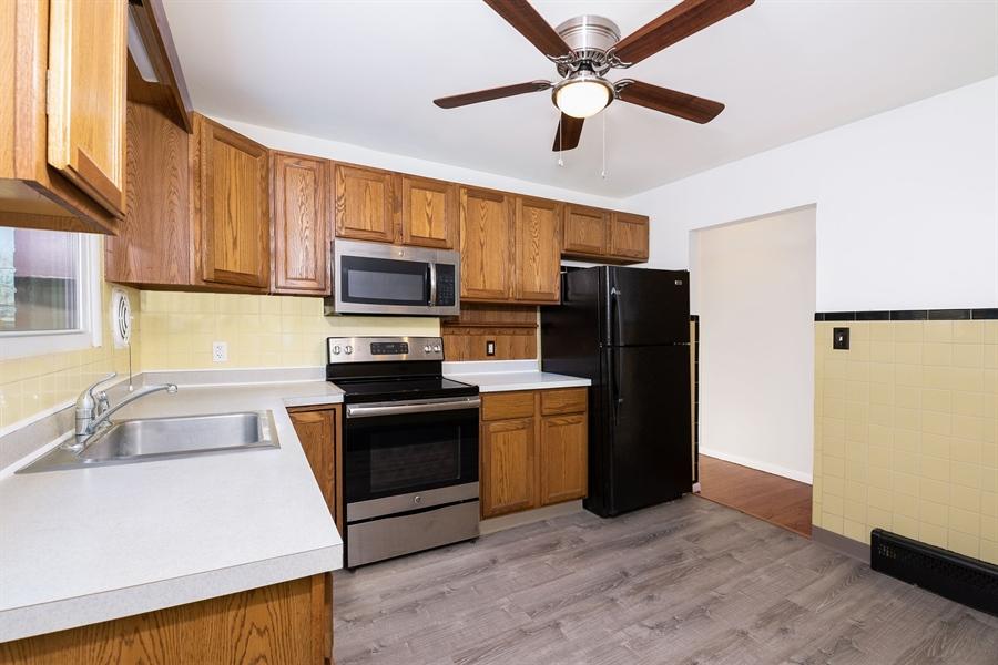 Real Estate Photography - 303 Valley Rd, Wilmington, DE, 19804 - Kitchen, New LifeProof Laminate Floor