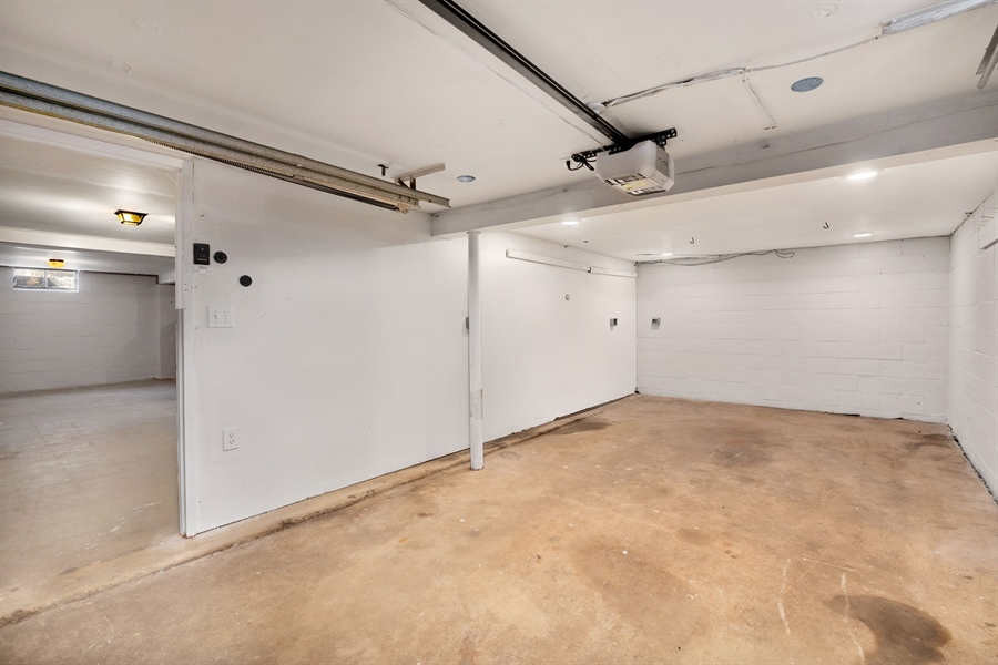 Real Estate Photography - 303 Valley Rd, Wilmington, DE, 19804 - Garage with Work Area to Basement