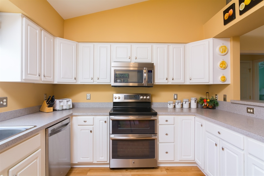 Real Estate Photography - 16 Beech Ln, Lewes, DE, 19958 - Kitchen with updated stainless steel appliances