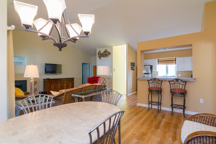 Real Estate Photography - 16 Beech Ln, Lewes, DE, 19958 - Dining Area and view into kitchen