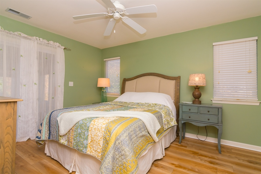 Real Estate Photography - 16 Beech Ln, Lewes, DE, 19958 - Master Bedroom with Entrance to Porch