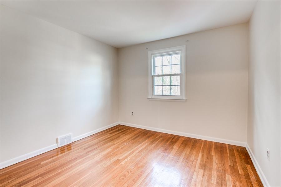 Real Estate Photography - 6 Saint Regis Dr, Newark, DE, 19711 - Third Bedroom With Hardwood Flooring