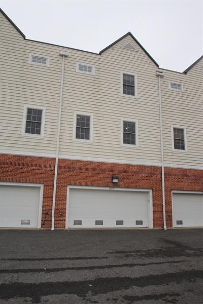 Real Estate Photography - 221 Christina Landing Dr, Wilmington, DE, 19801 - Rear of home with 2 car garage