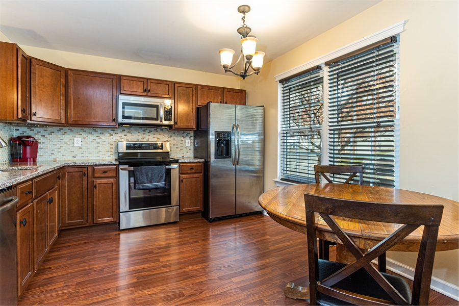 Real Estate Photography - 5032 E Woodmill Dr, Wilmington, DE, 19808 - Bright and Spacious Eat-In Kitchen