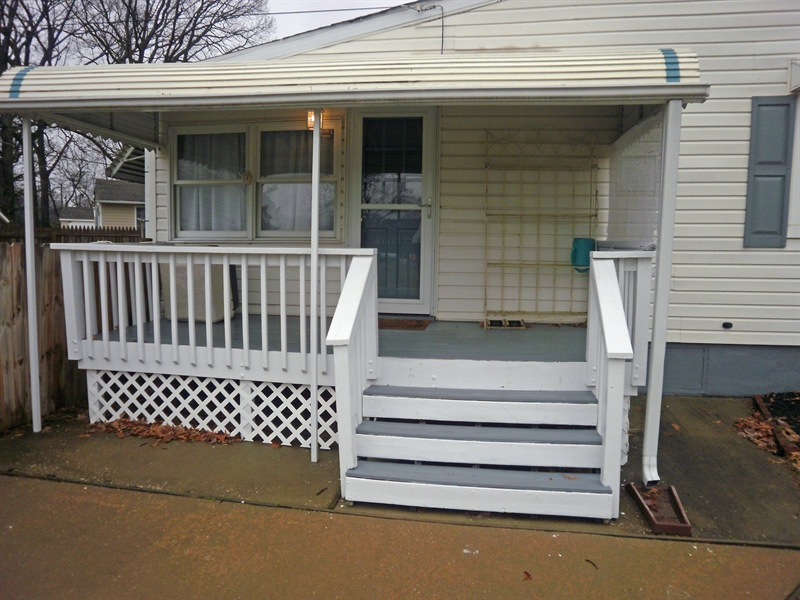 Real Estate Photography - 131 Saint John Dr, Wilmington, DE, 19808 - Side deck with awning off the driveway