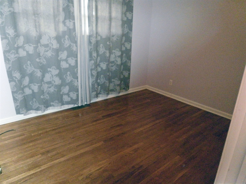 Real Estate Photography - 131 Saint John Dr, Wilmington, DE, 19808 - Wood floors in the 2nd bedroom with fan