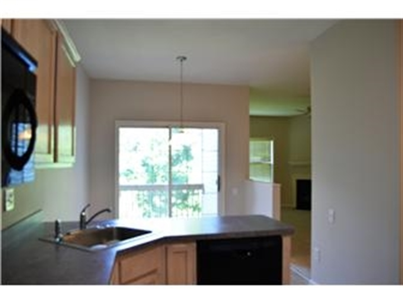 Real Estate Photography - 2208 Braken Ave, Wilmington, DE, 19808 - Eat-in Kitchen with Slider to deck