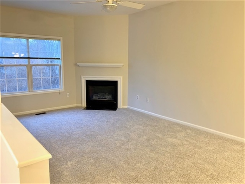 Real Estate Photography - 2208 Braken Ave, Wilmington, DE, 19808 - Nice size living room with gas fireplace