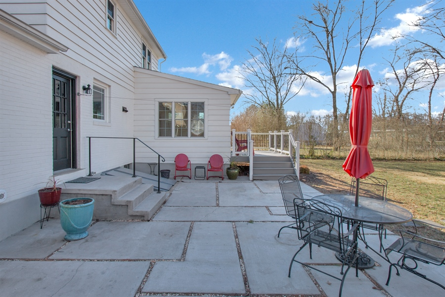 Real Estate Photography - 310 Apple Rd, Newark, DE, 19711 - Spacious Slate Patio with Deck