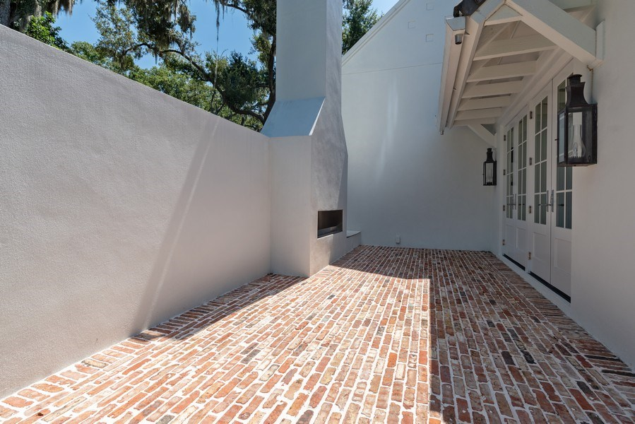 Real Estate Photography - 880 Bonita Drive, Winter Park, FL, 32789 - Patio w/ Fireplace Off Dining Area