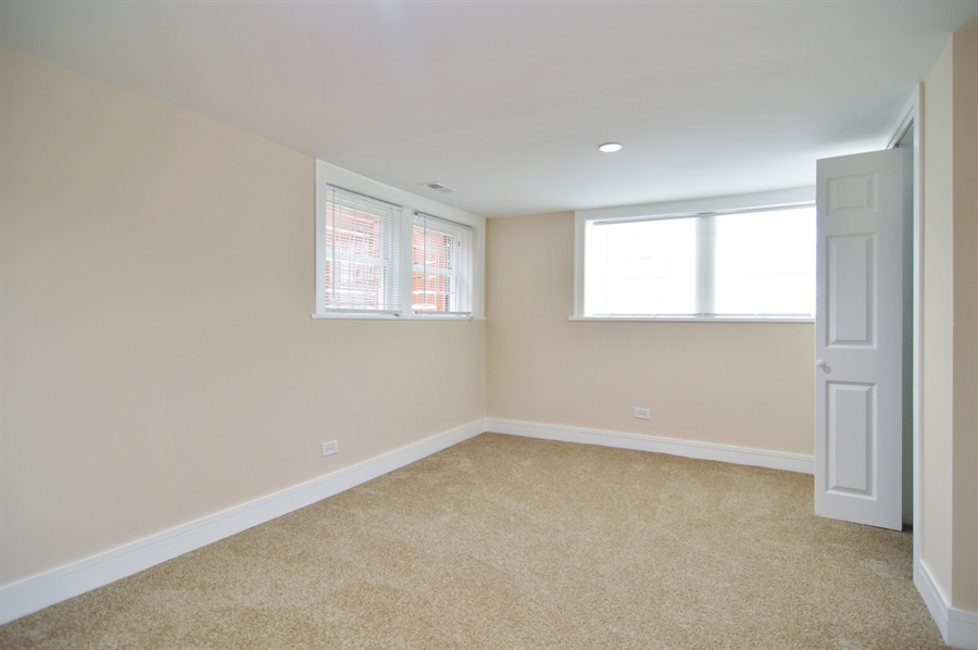 Real Estate Photography - 1637 N. Monitor Ave, Chicago, IL, 60639 - lower level bedroom nr.5