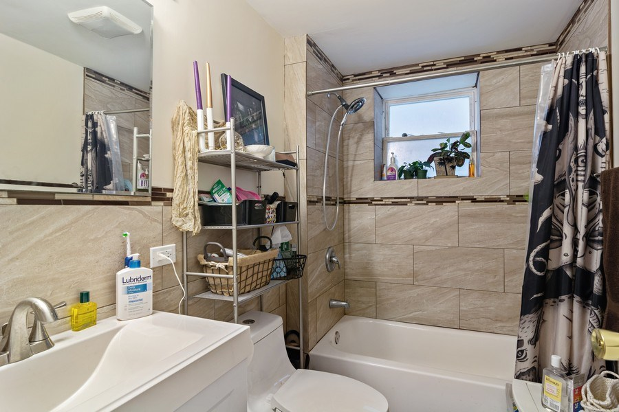 Real Estate Photography - 3633 N Elston Ave, Chicago, IL, 60618 - Bathroom - Apt 1R