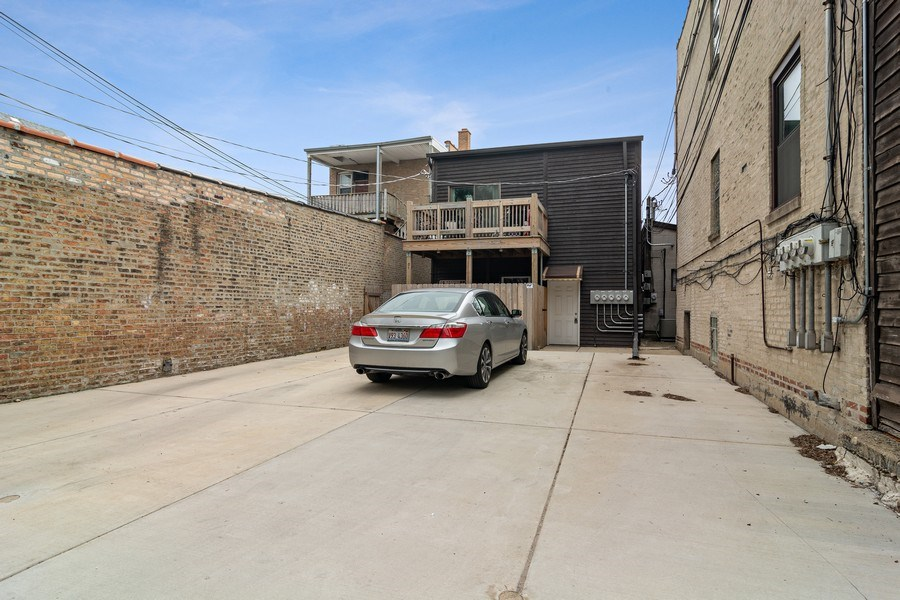 Real Estate Photography - 3633 N Elston Ave, Chicago, IL, 60618 - Parking - 3 Tandem Spaces (6 cars total)