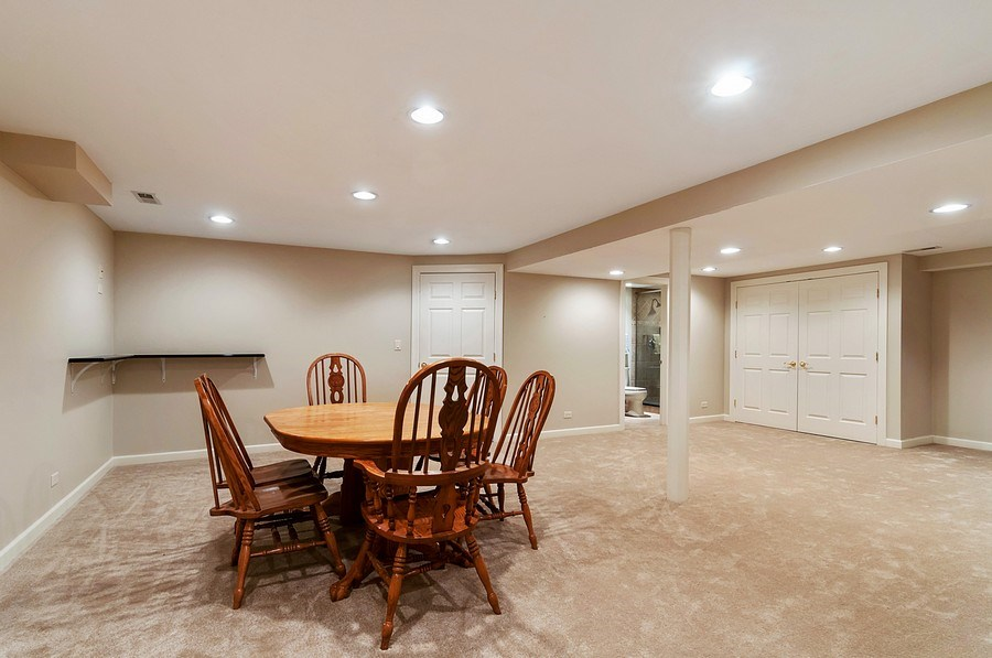 Real Estate Photography - 27W234 Warrenville Ave, Wheaton, IL, 60189 - Basement Pool/Ping-Pong Area