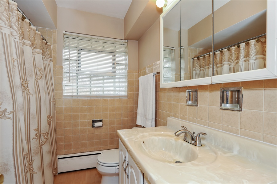 Real Estate Photography - 10647 Essex St, Westchester, IL, 60154 - Bathroom