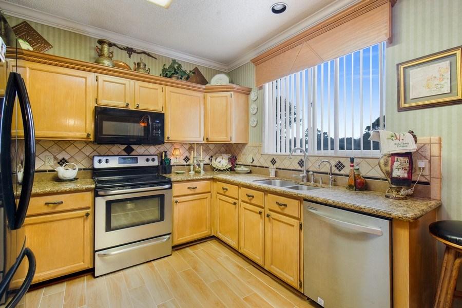 Real Estate Photography - 2142 Brighton Bay Trail W, Jacksonville, FL, 32246 - Kitchen