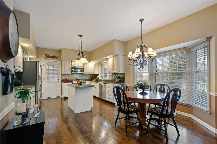 Real Estate Photography - 2S720 White Birch Lane, Wheaton, IL, 60189 - KITCHEN IS SPACIOUS AND HAS ISLAND AND TABLE SPACE