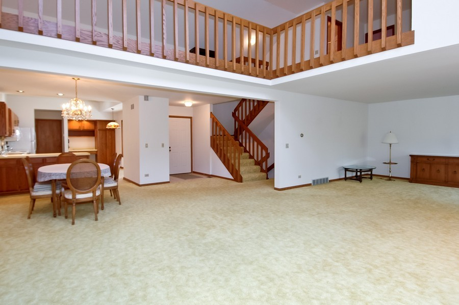 Real Estate Photography - 250 Spring Cove Rd, Elgin, IL, 60123 - Living Room / Dining Room