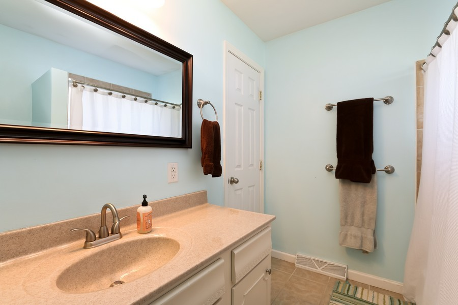 Real Estate Photography - 5548 N Flora, Kansas City, MO, 64118 - Bathroom