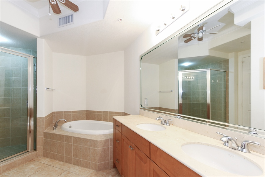 Real Estate Photography - 10733 Mirasol Dr. #307, Miromar Lakes, FL, 33913 - Master Bath with separate tub and shower.