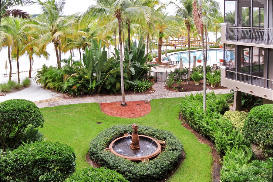 Real Estate Photography - 10733 Mirasol Dr. #307, Miromar Lakes, FL, 33913 - Tropical View from the balcony.