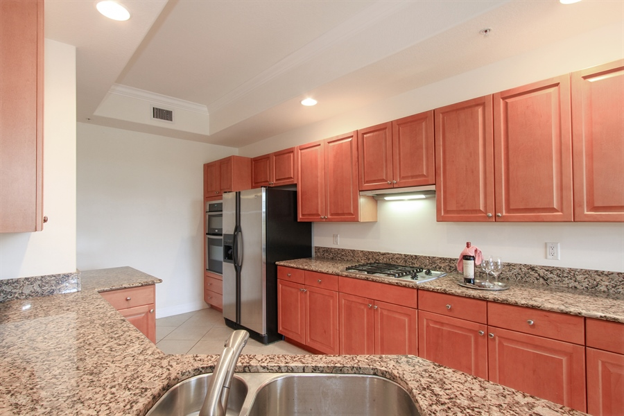 Real Estate Photography - 10733 Mirasol Dr. #307, Miromar Lakes, FL, 33913 - Spacious Kitchen * Natural Gas Cooktop