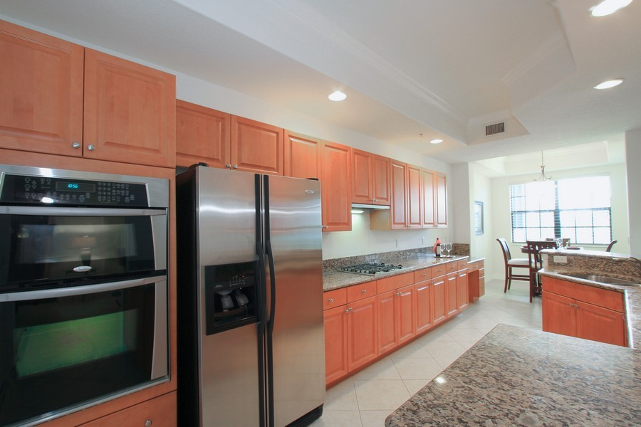 Real Estate Photography - 10733 Mirasol Dr. #307, Miromar Lakes, FL, 33913 - Gourmet Kitchen