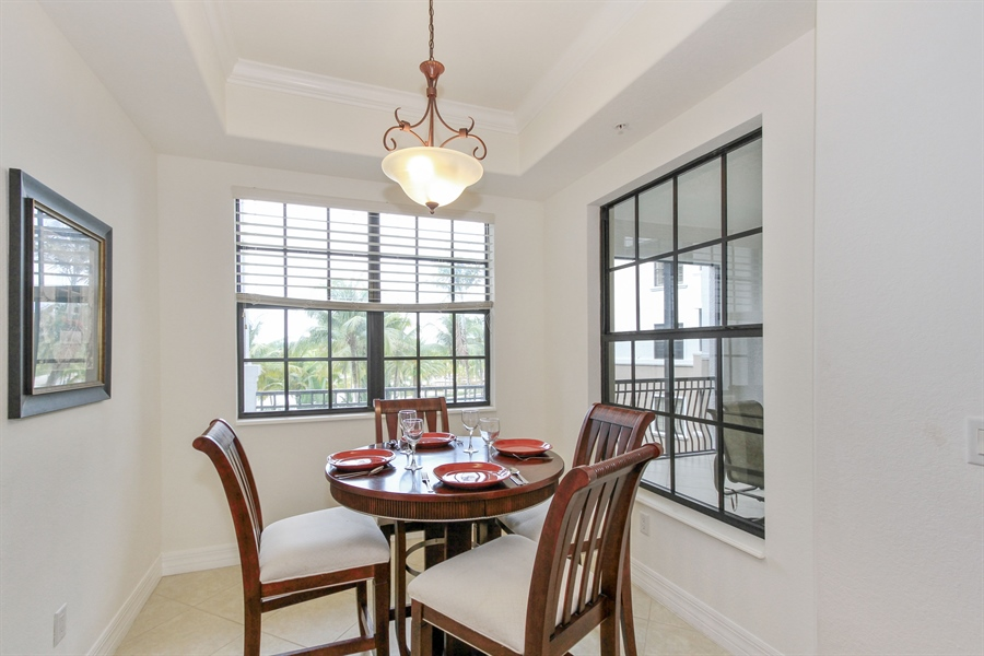 Real Estate Photography - 10733 Mirasol Dr. #307, Miromar Lakes, FL, 33913 - Sunny Breakfast Nook overlooking the water.