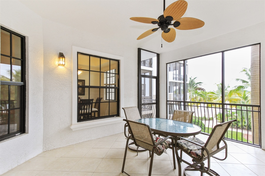 Real Estate Photography - 10733 Mirasol Dr. #307, Miromar Lakes, FL, 33913 - Screened Balcony overlooking the water with open s