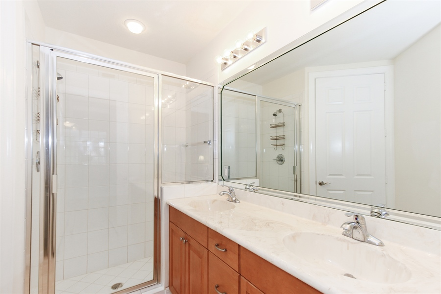 "Real Estate Photography - 10733 Mirasol Dr. #307, Miromar Lakes, FL, 33913 - Guest Bath of the second ""master""."